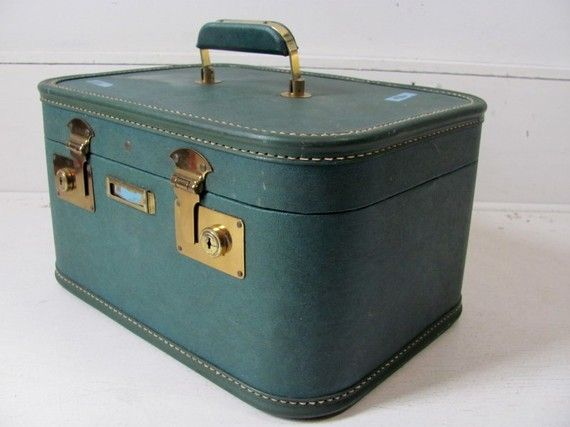We had this exact suitcase - can look at this picture and remember the smell of it.
