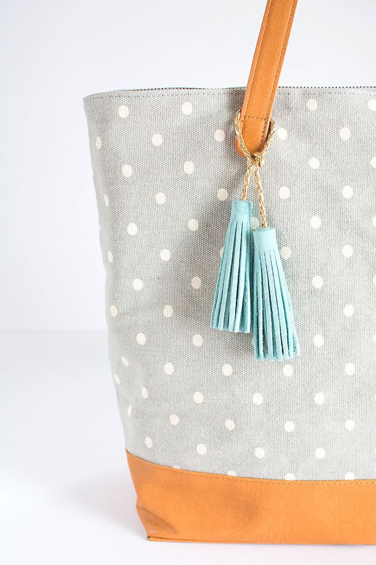 DIY Suede Leather Tassels - Cute idea for personalizing a tote bag! Look for materials to make these at your local #Goodwill store! www.goodwillvalleys.com/shop/