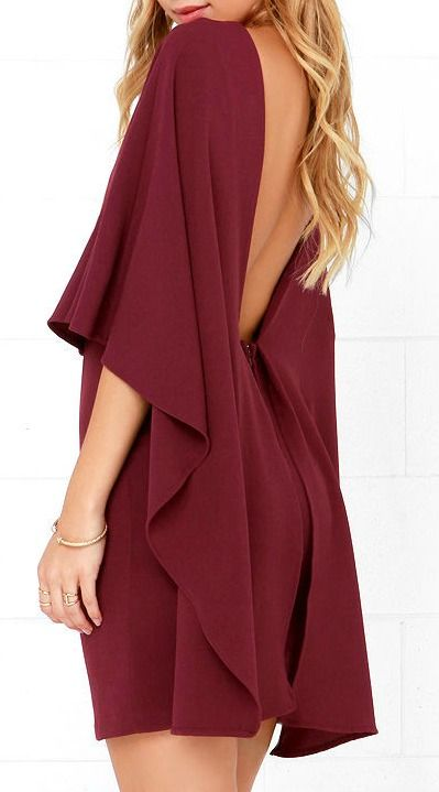 Things are looking up with items like the Best is Yet to Come Burgundy Backless Dress making their way into your wardrobe! A unique, backless silhouette is created by woven poly fabric that drapes into a front tier, and transitions into cape sleeves that trail out at back alongside the sheath skirt. #lovelulus