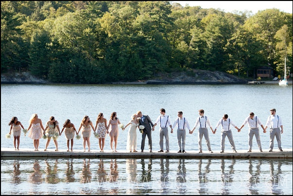 dock group shot!  #mangostudios #photography #wedding #weddingphotography #toronto #muskoka #weddingparty #bride #groom #suspenders #dress #dock #water #lake