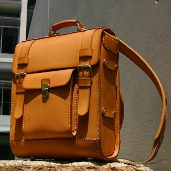 .Leather satchel style backpack