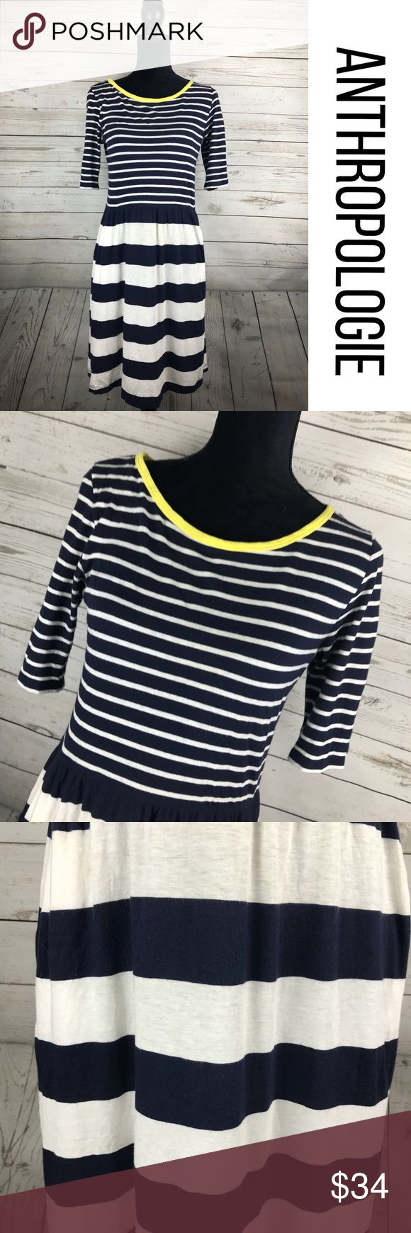 """Anthropologie Saturday Sunday Striped Navy Dress M Anthropologie Saturday Sunday Navy Blue Striped dress. Fitted elastic waist with a slight flare. Pockets. Lightweight, yellow trim. Gently used condition, tiny mark on the front -not very noticable,pictured.  Size M. Approximate measurements lying flat: Chest: 17"""" Length: 36"""" B1 Anthropologie Dresses"""