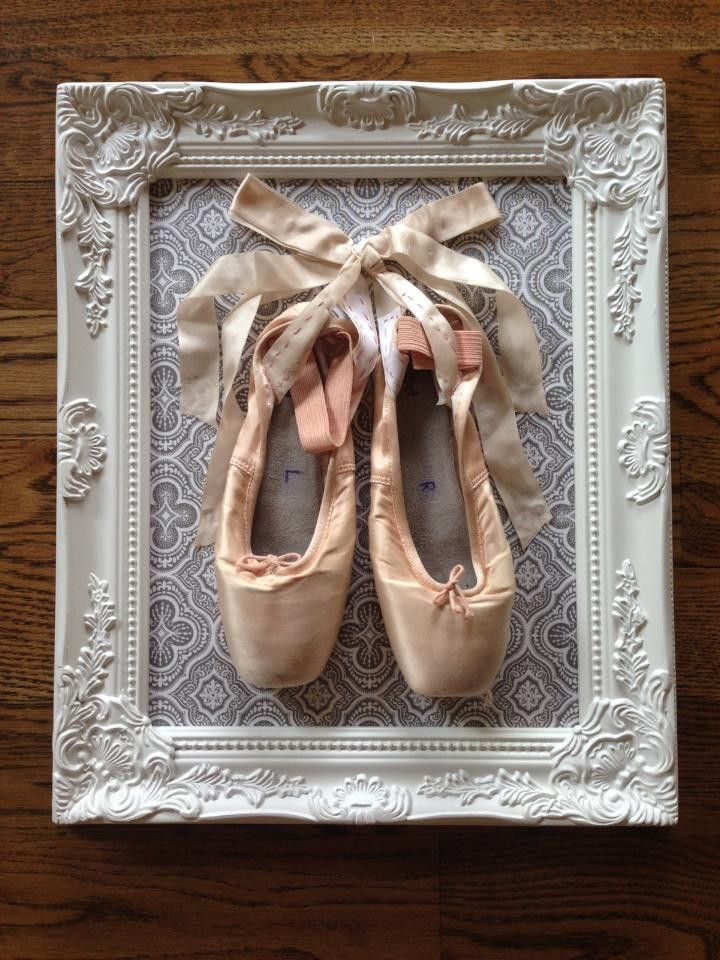 Cute way to display your first pair of pointe shoes. Supplies: Frame Canvas Fabric Pointe Shoes Glue gun Staple Gun Directions: 1. Cut your fabric so that it can completely cover your canvas. 2. Glue the fabric on the back side of the canvas. 3. Use a staple gun to staple the canvas into your frame. 4. Staple or use a glue gun to glue your pointe shoes to the fabric.