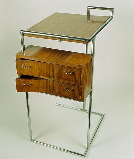 Eileen Gray: Little portable dressing table in chromed tubular steel and leather top designed for the #E1027 guest room