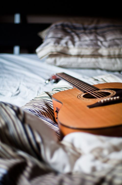 Playing guitar in bed