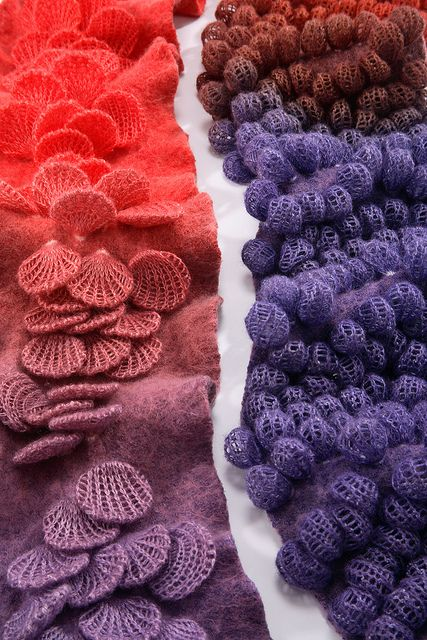 Jeung-Hwa Park uses beans, nuts or pieces of wood in these machine knitted fabrics. It's called shibori.