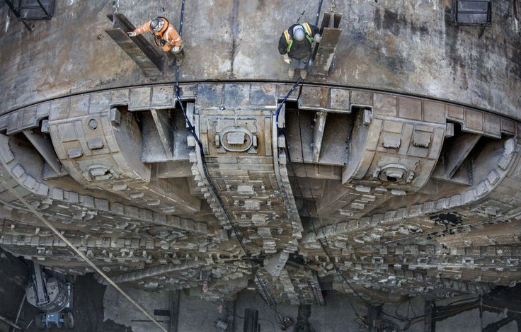 More than 150 feet below the streets of Seattle, Bertha presses on, boring a 57.5-foot diameter tunnel underneath the city. The largest tunnel boring machine (TBM) in the world when it was built, Bertha weighs a gargantuan 6,700 tons and stretches 326 feet long.