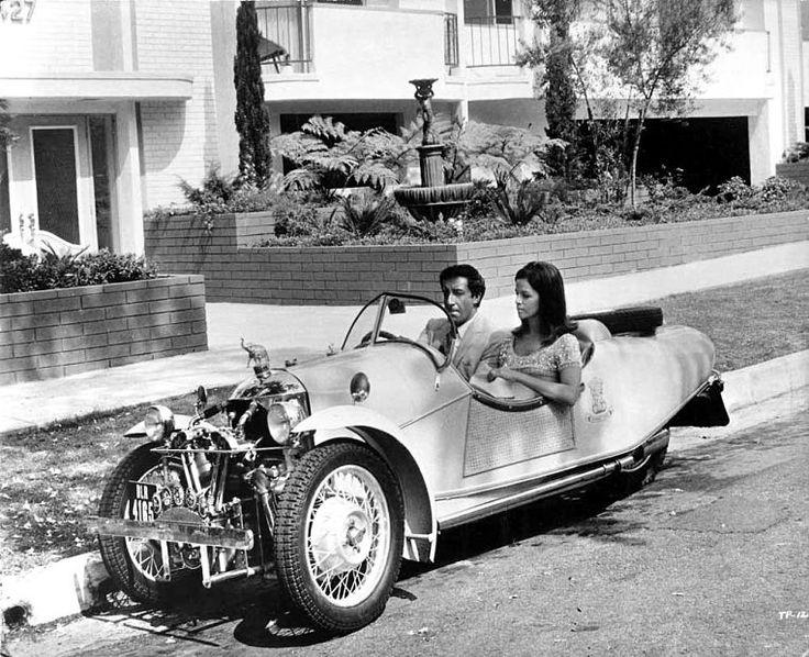 A still from the 1968 film The Party - Peter Sellers & Claudine Longet in a 3 wheeler Morgan Sport car built between 1932 & 1937
