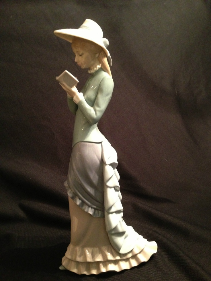 Lladro statue lady reading a book   Books