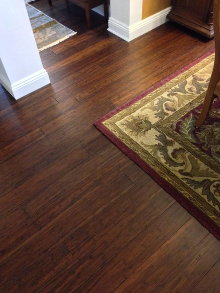This dark brown bamboo, with its deep, rich hues and luxurious shine, instantly upgrades any space. | Featured Floor: Antique Hazel Bamboo