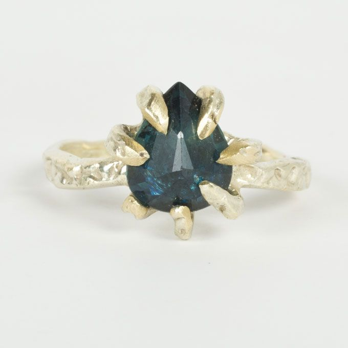 Lauren Wolf. Blue sapphire 1.85 carat ring in a deep ocean blue with signature claw style in solid 14k green gold, $1,100, Lauren Wolf available at Catbird