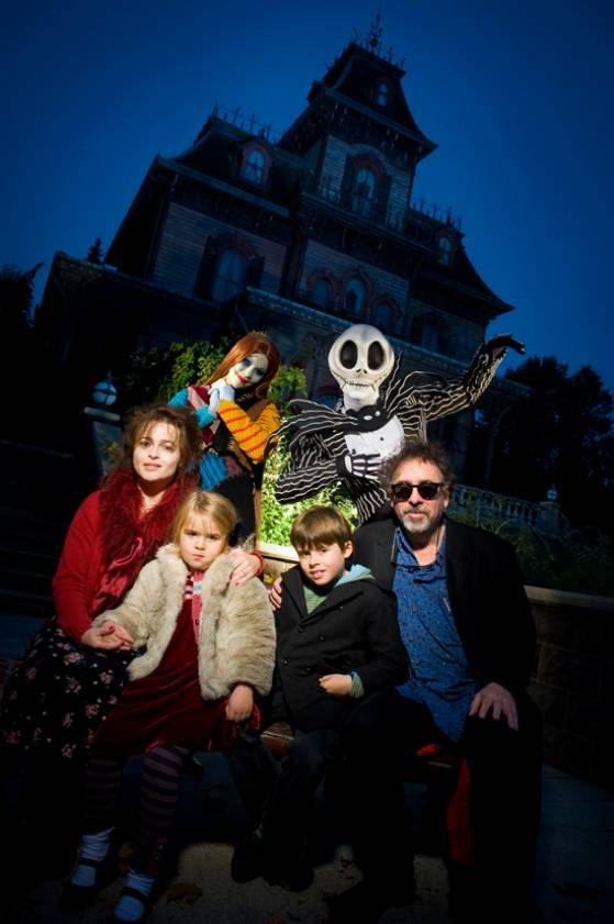 Tim Burton and Helena Bonham Carter with kids in front of the Haunted Mansion in Disneyland Paris--- can you imagine what life would be like with these parents? haha