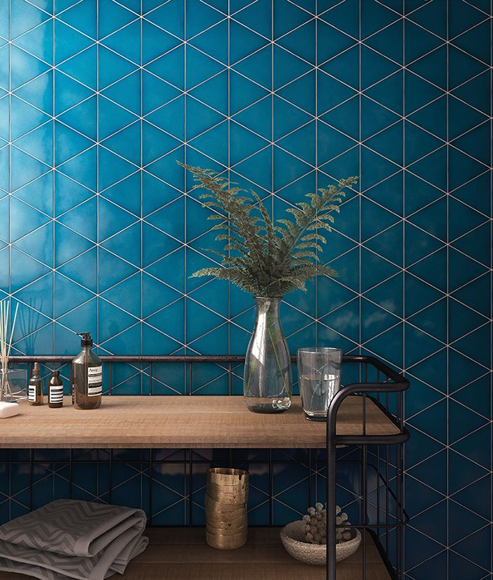 Triangles and irregular hexagons, that allow for creative customisation and stunning #geometrical compositions. Available in neutral tones, elegant gold and bold blue.  #metallic #interiortrend #interiordesign #tiles #geometric #sds17 @surfacethinking