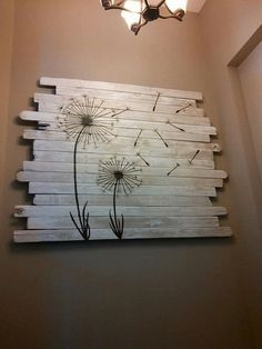 upcycle old wood scraps by tacking them together and adding a peel and stick wall applique.