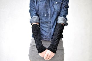 These arm-warmers are like unattached sleeves that one can wear with all the short or 3⁄4 sleeves that just don't cut it when the weather gets colder. The good thing about them is that they also double as fingerless gloves if worn very low on the hands!
