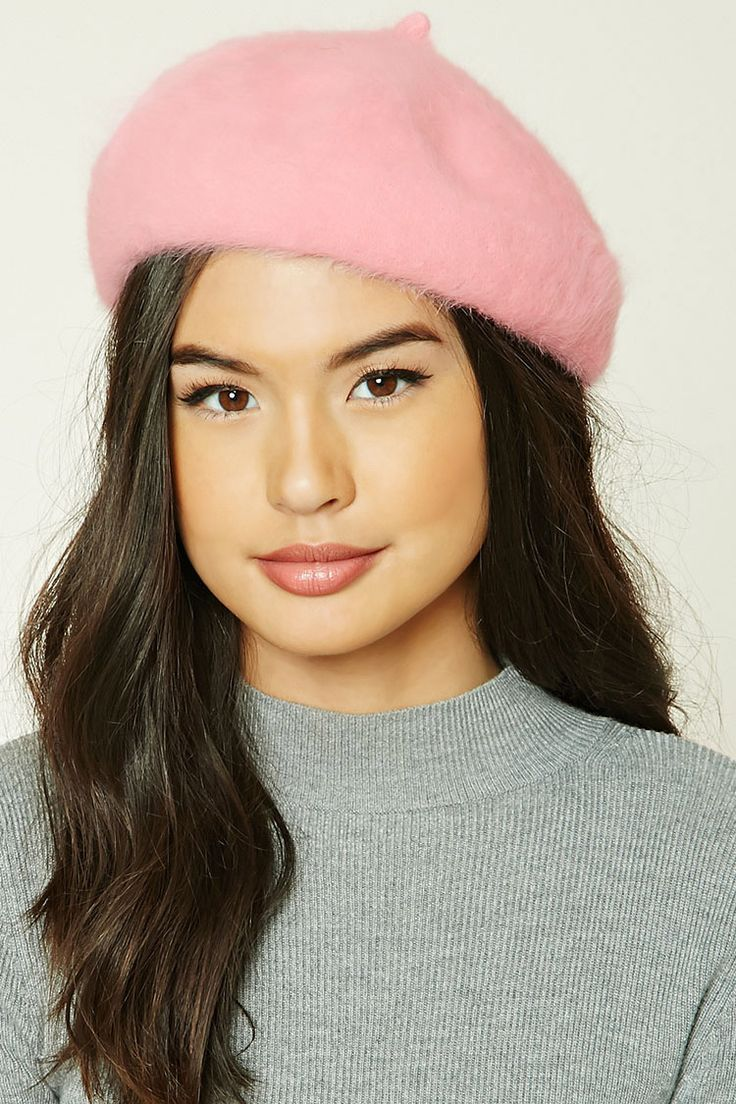 A rabbit hair-blend slouchy beret featuring a fuzzy knit design and an elasticized brim.