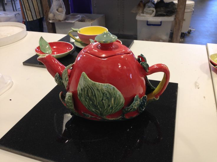 Hand built teapot reverses siide