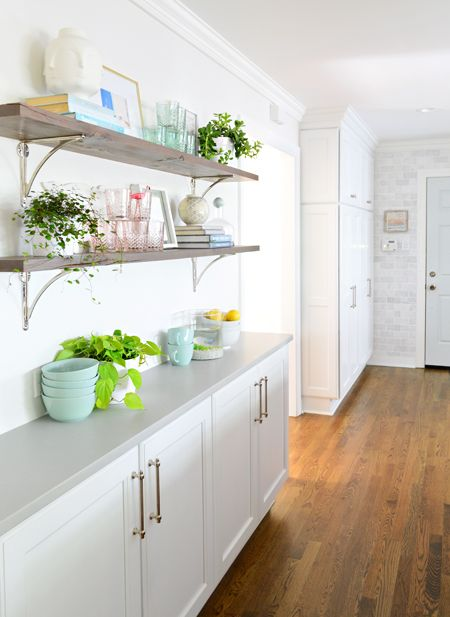 """Our kitchen renovation! Loving the open shelves and those cabinets in the back by the door are actually a """"hidden mudroom"""" for coats and bags and shoes and backpacks 👌❤️🎉🙌"""