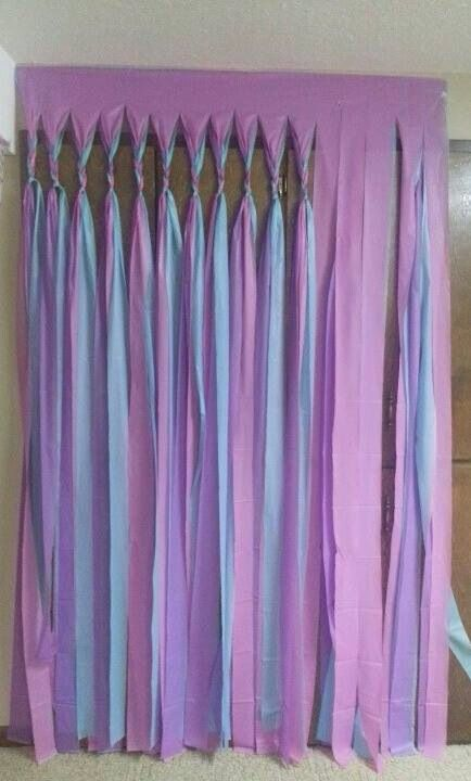 Several plastic table cloths cut to make a curtain for a party