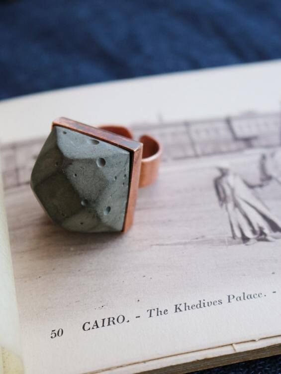 Our concrete and copper ring is the first item in our new range of concrete jewellery and is already proving to be a big hit with the girls who love something a bit different! The base is solid copper with an adjustable band and the 'gemstone' is solid concrete. You can let your ring tarnish to create a beautiful patina or you can keep your ring shiny with commercial copper cleaners or.....a quick rub with tomato sauce!! Your product will be packaged in a beautif
