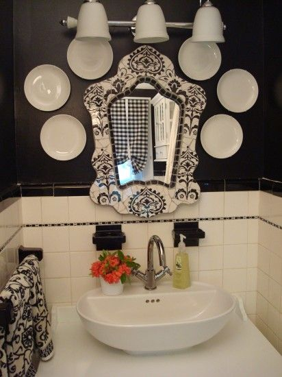 Get creative using everyday items, like a collection of porcelain plates from HomeGoods as art, in not-so-everyday places. These plates help make this HomeGoods vintage-inspired mirror even more of a focal point in the powder room. Contributing designers may receive compensation.