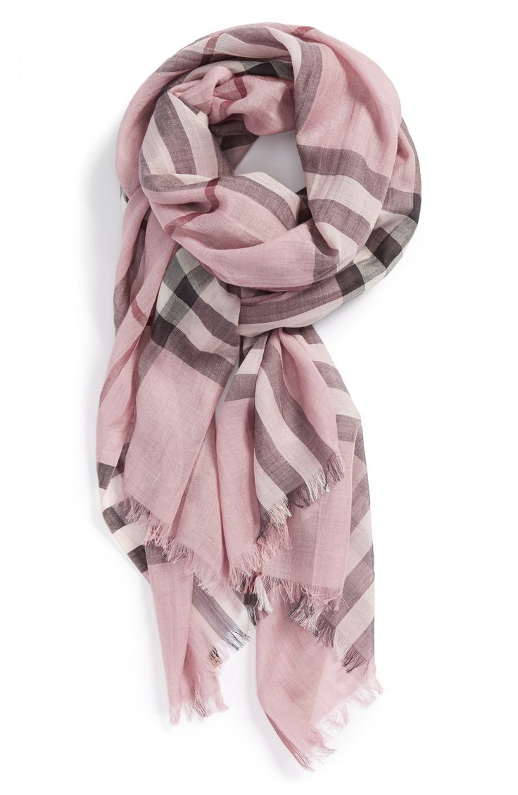 This pastel pink Burberry check print scarf is perfect for fall.