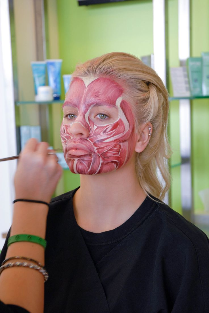 Tricoci University student Hayley Beck performs a Kryolan make-up demo of the facial muscle tissue at the Glendale Heights campus.