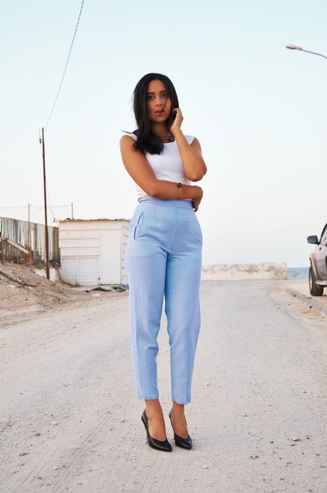 Shop this look on Lookastic:  http://lookastic.com/women/looks/white-tank-light-blue-dress-pants-black-leather-pumps/4389  — White Tank  — Light Blue Dress Pants  — Black Leather Pumps