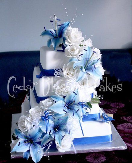 Blue lilies and white rose wedding cake