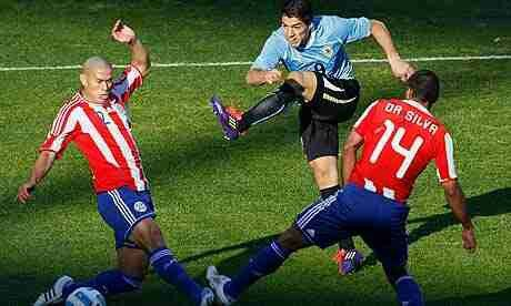 Uruguay 3 Paraguay 0 in 2011 in Buenos Aires. Luis Suarez shoots for goal as Uruguay dominate in the Final of Copa America.