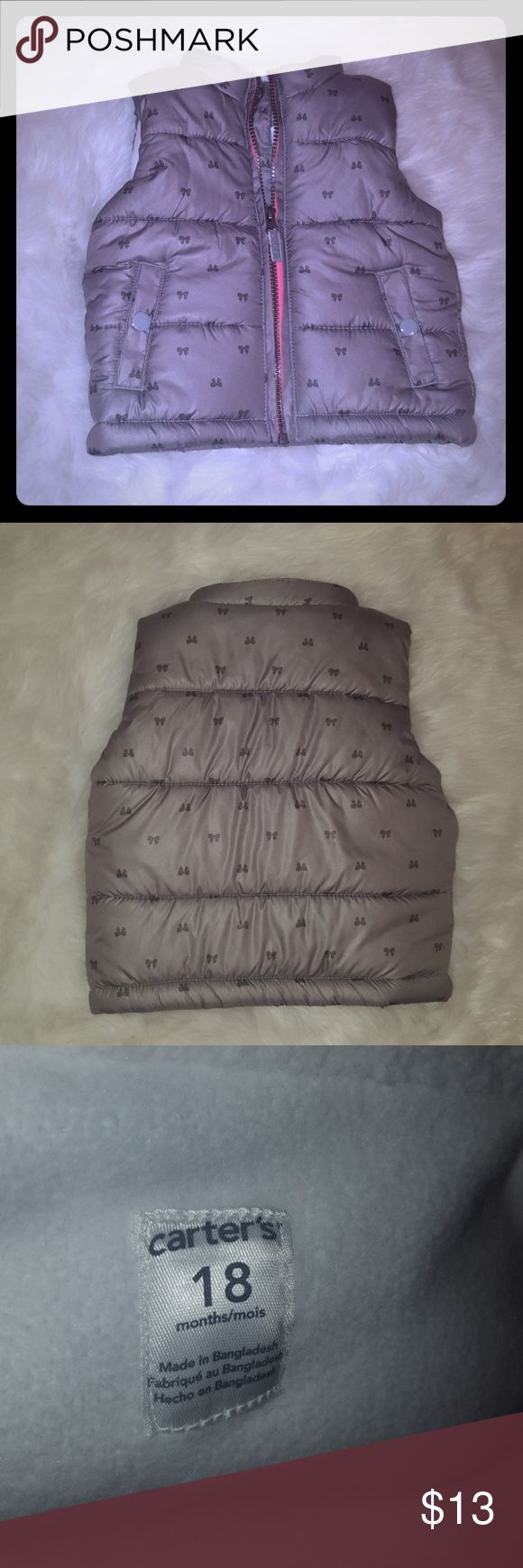 Carter's baby girl vest 18mo Carter's gray best w/bows pattern, white fleece inside w/pink accent zipper. In excellent condition, no tears, no stains, size 18months. Carter's Jackets & Coats Vests