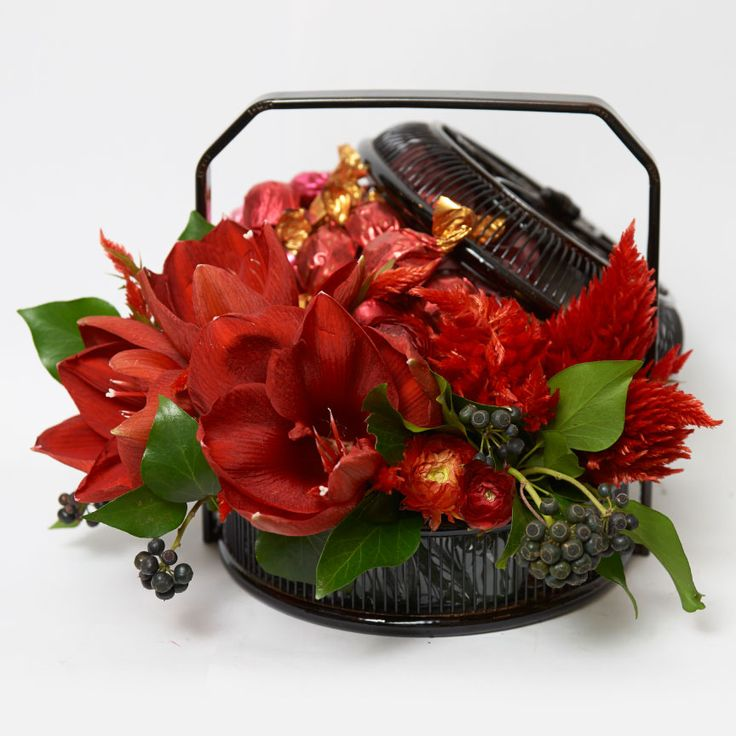 Fresh, blooming flowers are traditionally displayed around the home during Chinese New Year as a sign of prosperity for the year to come. Choose from an assortment of lovely, Asian-inspired floral arrangements and gift baskets from Ellermann. There are baskets that are filled with gourmet sweets and accented with beautiful flowers in auspicious crimson and pink shades.