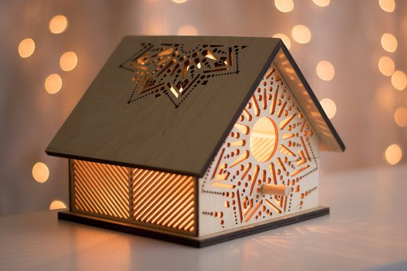This little laser cut wooden birdhouse has been fitted with a softly glowing low watt bulb, making it perfect for a nursery or kids room night light, or an interesting addition to any other space. The light shining through the cut holes casts patterns on the walls and ceiling, softly illuminating the room around it.  --------------------  S P E C I F I C A T I O N S :  6 tall x 7 wide x 6 deep 15 cm tall x 18 cm wide x 15 cm deep  High quality Baltic Birch plywood Natural bare finish…