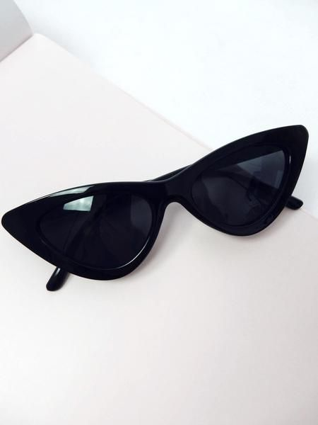 NEW black sunglasses. Brand / Bamona Small cat eye shape Black plastic frame Black tinted lens Acetate/polycarbonate Lens width / 7cm Lens height / 4.5cm