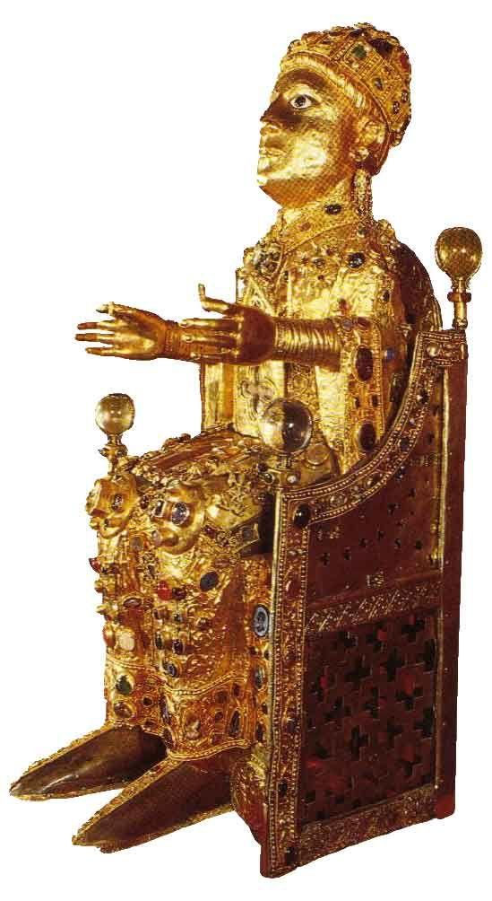 """La Statue-reliquaire de sainte Foy, appelée La Majesté de sainte Foy est une  statuette de 85 cm de haut la statuette est fait de feuille d'or, de marbre, argent doré, gemmes et émail.C'est la pièce maîtresse du trésor que renferme l'abbatiale romane de Conques, principalement car elle se trouve être la seule """"Majesté"""" carolingienne qui soit parvenue jusqu'à nous.Le crâne de Sainte-Foy était placé dans le dos de la statue"""