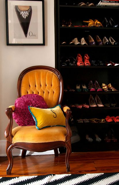 Shoes! photo House of Fifty Mag, via Flickr #orange #chair #shoes #closet #bookshelf #display