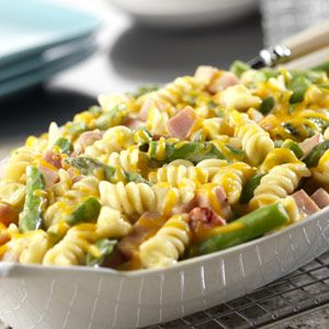 Ham, cheese and asparagus are baked together with seasonings and corkscrew pasta in a cheesy sauce to make this savory baked casserole.