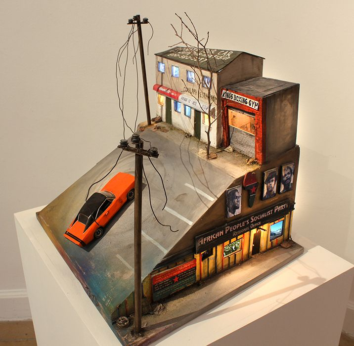 Oakland Sideshow, 2013, Wood, lights, fake concrete, slot car, motor, LCD screens, media players, speakers, transformer, 44 x 48 x 40.5 cm, unique