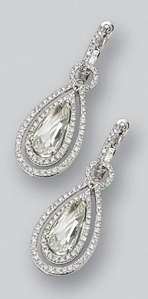 PAIR OF DIAMOND PENDANT-EARRINGS. The swing pendants set with 2 pear-shaped rose-cut diamonds weighing approximately 3.00 carats, framed by small round diamonds, supported by hinged hoops, the round diamonds weighing a total of approximately 1.00 carat, mounted in 18 karat white gold.