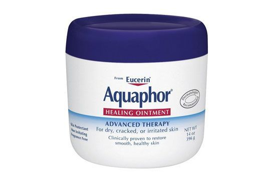 """""""If the blemish has been picked at or has a scab, I like to do a thin veil of Aquaphor [and] then apply a cream or light foundation to cover the pimple. I then set with a very matte foundation powder, so that it seals the makeup while making the blemish unnoticeable and stays covered all day long. If it's just a raised, inflamed blemish, I do the same as the above, except I don't..."""