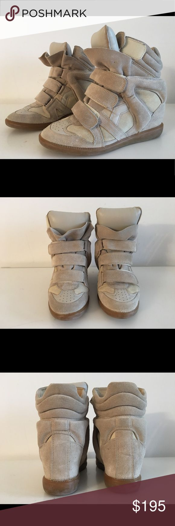 "ISABEL MARANT BECKETT WEDGE HEEL SNEAKERS SIZE 40 ISABEL MARANT BECKETT WEDGE HEEL SNEAKERS SIZE 40 HIDDEN WEDGE APPROX 3 1/2"" ROUND-TOE HIGH TOP WITH CONCEALED WEDGE RUBBER SOLE AND VELCRO CLOSURES AT UPPERS  USED IN GOOD CONDITION Isabel Marant Shoes Sneakers"