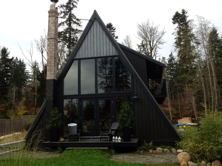 Halfway to Painting the cabin black... The Little black house! Our a-frame cabin is now black, and it looks beautiful!