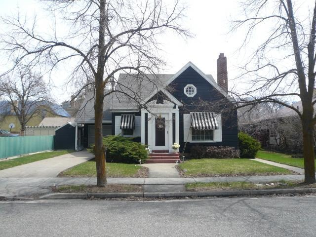 House exterior with navy blue siding, bright white trim, and striped awnings. Can't believe I found this on Pinterest. Cute little house I've long admired in Logan, Utah.