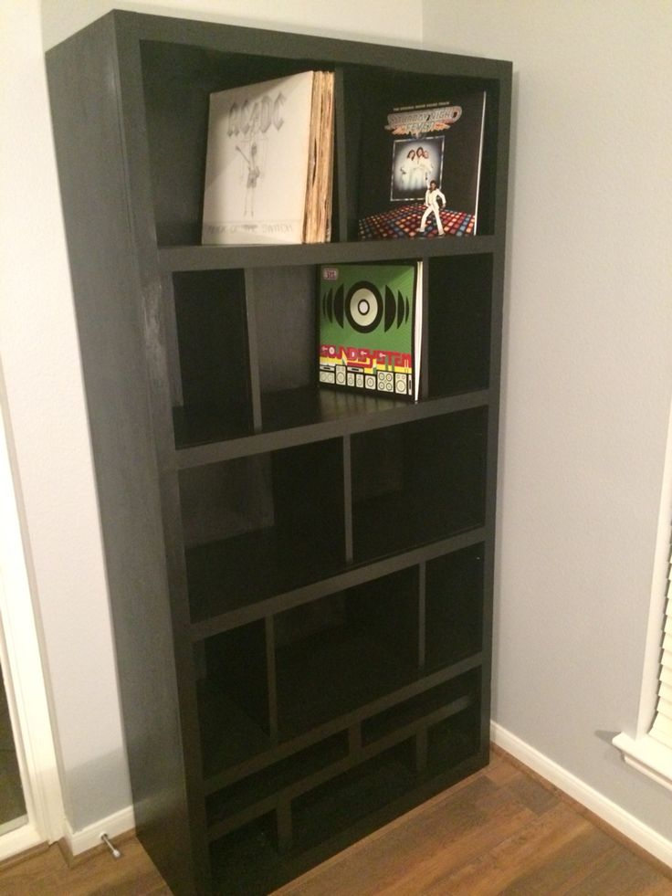 the vinyl record shelf has officially been installed and