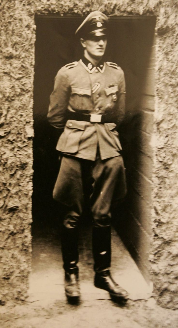 Hitler's bodyguard and telephone operator Rochus Misch is seen in Hitler's bunker 'Wolfsschanze (Wolf's lair)' in Poland in this 1944 photo.