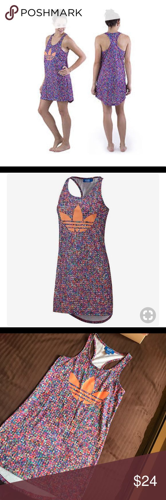 Adidas Multicolored ZX flux tank dress This fantastic top is described by adidas as a tank dress, but unless you're very daring we prefer to call it a long tank.   100% polyester Scoop neck Racer back Dropped rear hem Allover geometric print Large trefoil transfer adidas Dresses Mini