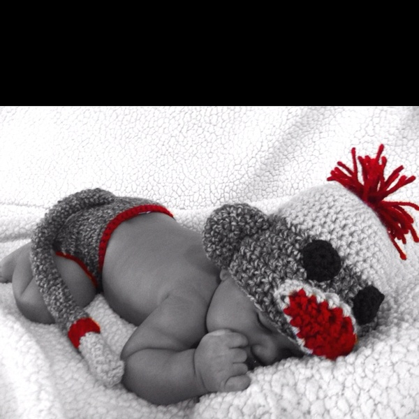 Sock monkey hat and diaper cover with tail that I crochet. My baby is 2 months and I finally took pics putting them on him. cabitt