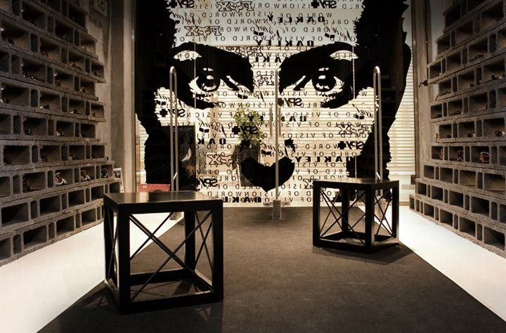 Sunglasses store ... cinder blocks are used as wall display fixtures. Love the large black & white photo on the back wall, too.