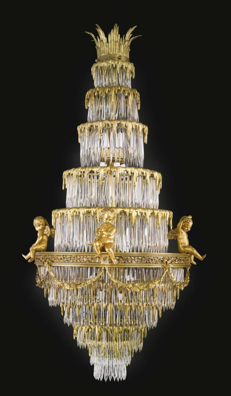 attributed to Cristalleries de Baccarat<br>A gilt-bronze and cut crystal  twenty four light chandelier<br>France, late century
