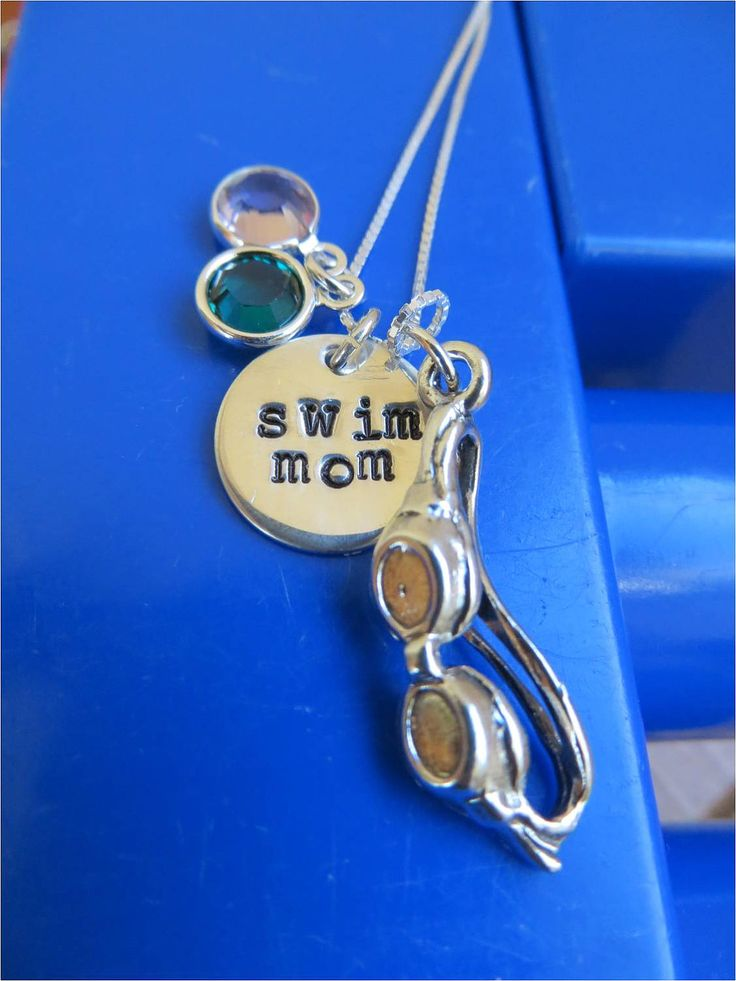 Sterling silver Swim Mom necklace with hand stamped charm, swim goggles and Swarovski birthstone charms-great Valentine's Day gift. $38.00, via Etsy.